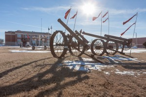 MT Liggett cannons pointing at the Kiowa County Courthouse; Greensburg, KS 2015