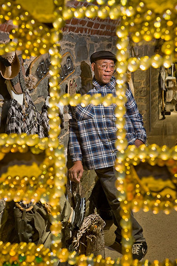 Willie Jordan in his installation at the Erie Art Museum; Erie, PA 2012 (c)